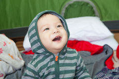 Baby boy in jacket with hood. Baby boy in jacket with green hood Royalty Free Stock Photography