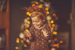 Baby boy on kid`s Christmas party royalty free stock images