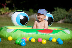 Baby boy and kids rubber pool Stock Images