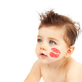 Baby boy with kiss. Photo of cute baby boy with red kiss on the cheek, closeup portrait of nice child with blue eyes isolated on white background, Valentine day Royalty Free Stock Images