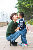 Baby boy kiss his mother. The baby boy is kissing his mother Stock Photo