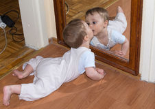 Baby boy kiss in mirror.  Stock Photography
