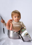 Baby boy in the kitchen pan Royalty Free Stock Photo