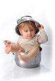 Baby boy in the kitchen pan Stock Photos