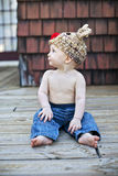 Baby boy in knit hat. A cute baby boy wearing jeans and a reindeer hat looking off to left Stock Photo