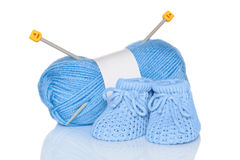 Baby boy knitted booties Stock Photos