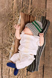 Baby boy in knitted hat. Stock Image