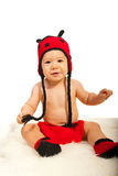 Baby boy in ladybug hat and boots Royalty Free Stock Images