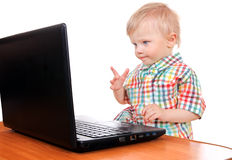 Baby Boy with Laptop Stock Images