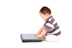 Baby boy with laptop in studio Royalty Free Stock Photography