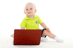 Baby boy with laptop. Royalty Free Stock Photo