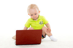 Baby boy with laptop. Royalty Free Stock Image