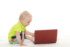 Baby boy with laptop. Royalty Free Stock Images