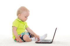 Baby boy with laptop. Royalty Free Stock Photography