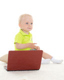 Baby boy with laptop. Stock Photography