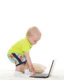 Baby boy with laptop. Stock Photos