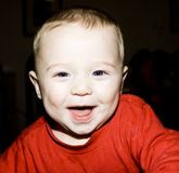 Baby boy laughing Stock Image
