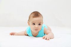 Baby boy laying on bed Royalty Free Stock Image