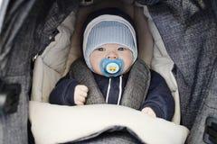 Baby boy  in the  stroller Stock Photos