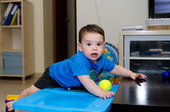 Baby boy leaning on a table Stock Photography