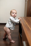 Baby boy learning to stand Royalty Free Stock Photography