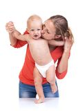 Baby boy learning to walk with mother's help Stock Photos