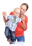 Baby boy learning to walk with mother's help Stock Photo