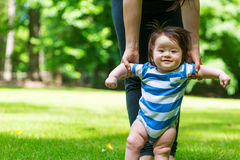 Baby boy learning to walk outside Stock Photography