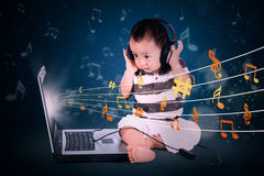 Baby boy listening to music Royalty Free Stock Photography