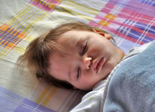 Cute baby sleeping. Baby boy , little baby sleeping on colorful background Royalty Free Stock Photography
