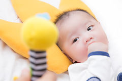 Free Baby Boy Looking At The Doll Stock Photos - 79147333