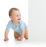 Baby boy looking out empty banner Stock Photo