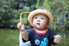 Baby boy looking Stock Photo