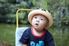 Baby boy looking Stock Images