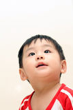 Baby boy looking up Stock Images