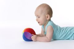 Baby boy looks at ball Royalty Free Stock Photos