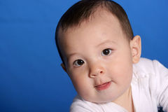 Baby boy looks up. A cute little baby boy looks up into the camera Stock Photo