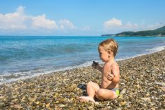 Baby boy in lotus pose on beach Stock Photography