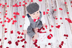 Baby boy in love. Lovely baby boy in barret sitting with betrothal ring Royalty Free Stock Images