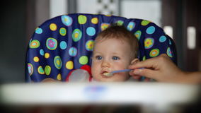 Baby boy at lunch time stock footage
