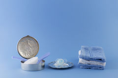 Baby boy luxury items on pale blue background Royalty Free Stock Images