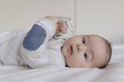 Baby boy lying on back Stock Images