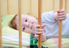 Baby boy lying in bed Royalty Free Stock Photography