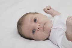 Baby Boy Lying In Bed. Closeup of a baby boy lying in bed Stock Images
