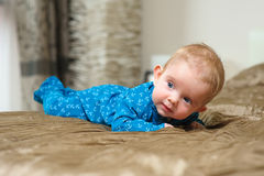 Baby boy lying on belly Stock Images