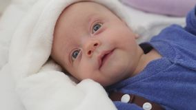 Baby boy in crib. Baby boy is lying in the crib, looks at his parents. baby calm and clean stock footage