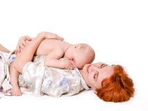 Baby boy lying on his mother Stock Photos