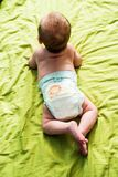 Baby boy lying on his tummy Royalty Free Stock Image