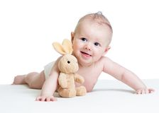 Baby boy lying with plush toy Stock Images