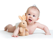 Baby boy lying on tummy with bunny toy Royalty Free Stock Photos